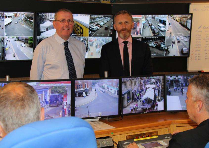 SKDC's Cabinet Member for Environment Coun Dr Peter Moseley and SKDC's Business Manager for Neighbourhoods Mark Jones in the CCTV control room.