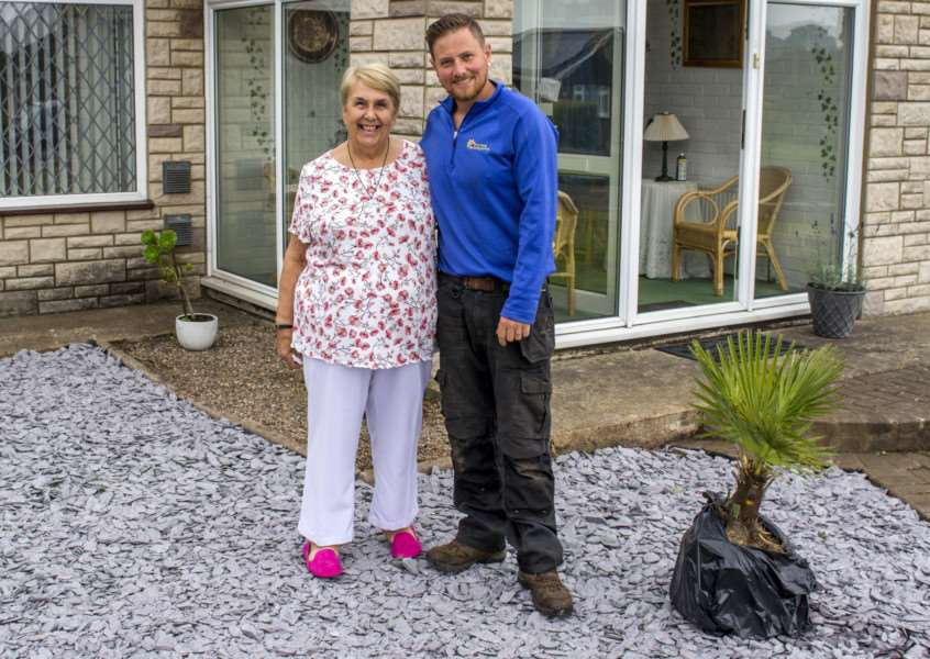 Pam Laverick and Chris Young in the blitzed garden
