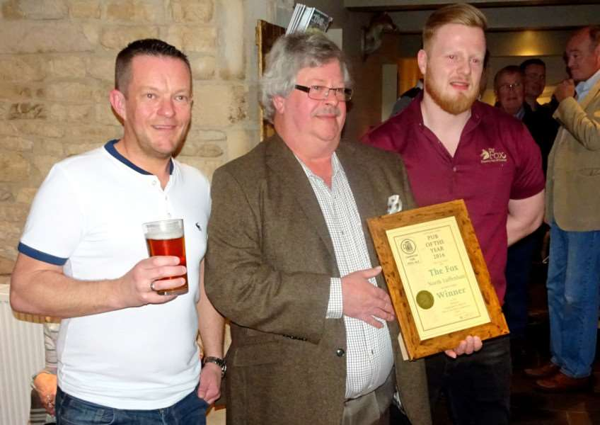 Jason Allen, owner of The Fox North Luffenham with David Laughton, from Rutland CAMRA and Tom Wilmot, supervisor at The Fox EMN-160405-111709001