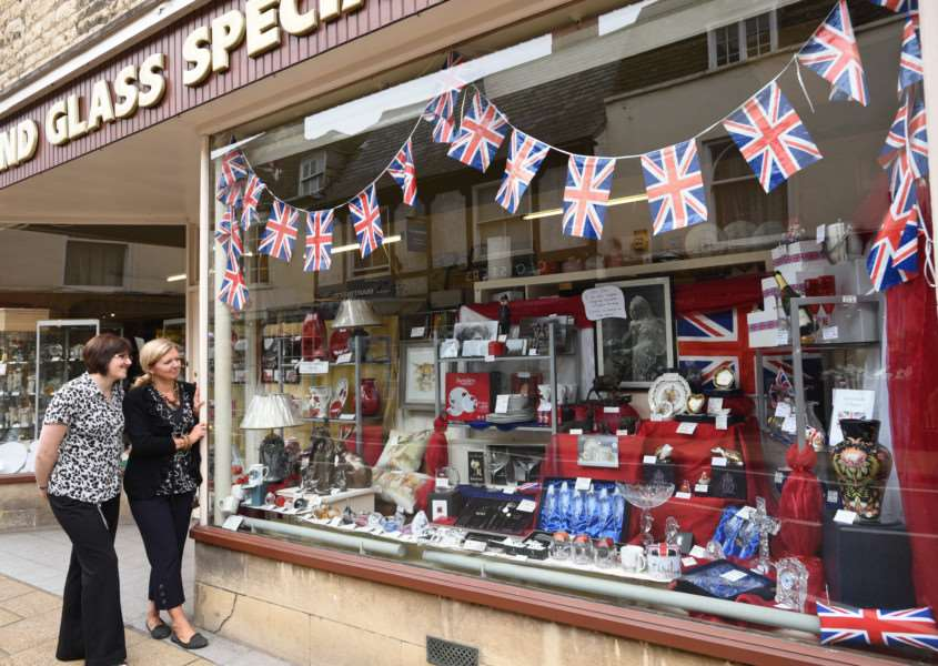 Maria Hayden and Alison Towers at Lamb's shop at Stamford with their window display to commemorate the longest reigning monarch Queen Elizabeth II EMN-150826-094004009