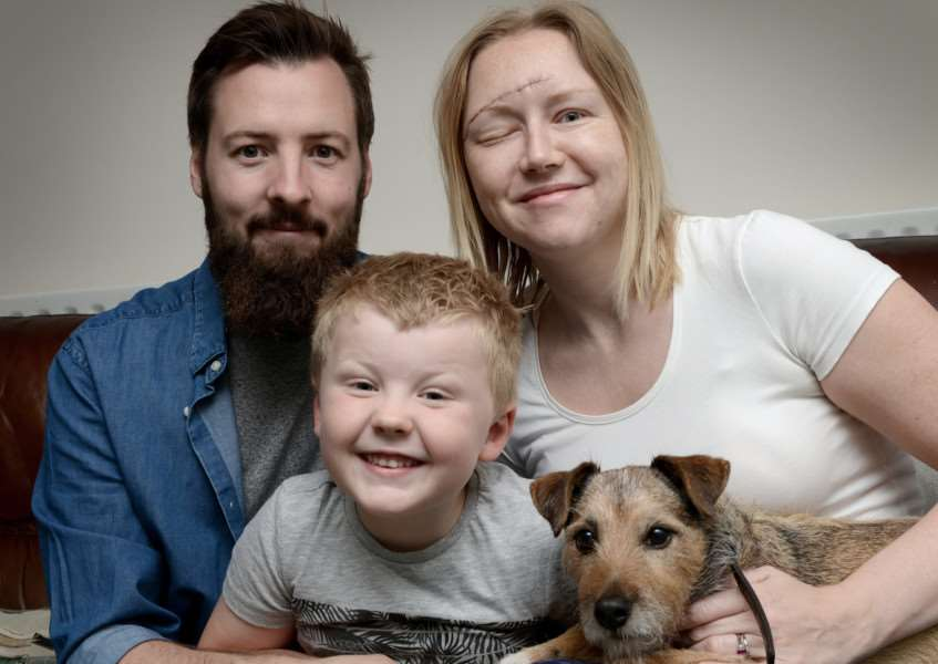 Katie Addison-Snart with husband Rob, son Hugo and Ben the dog.
