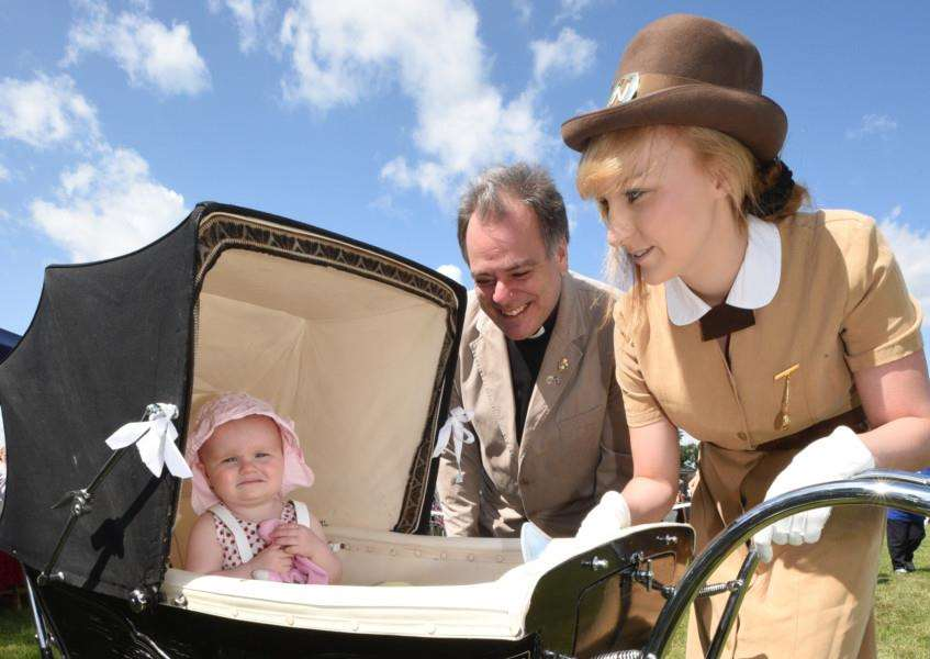 Armed Forces Day event at Market Deeping. Revd. Philip Brent with Tiffany West and daughter Bryanna (1) in 1940's pram EMN-150628-202252009