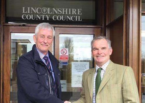 Former UKIP county councillor Robert Foulkes is welcomed to the Conservative Party by council leader Martin Hill EMN-161213-094822001
