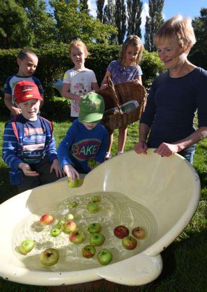 Harvest Festival at Sacrewell Farm. Children taking part in activities with Stephanie Bradshaw (right) EMN-150927-165816009