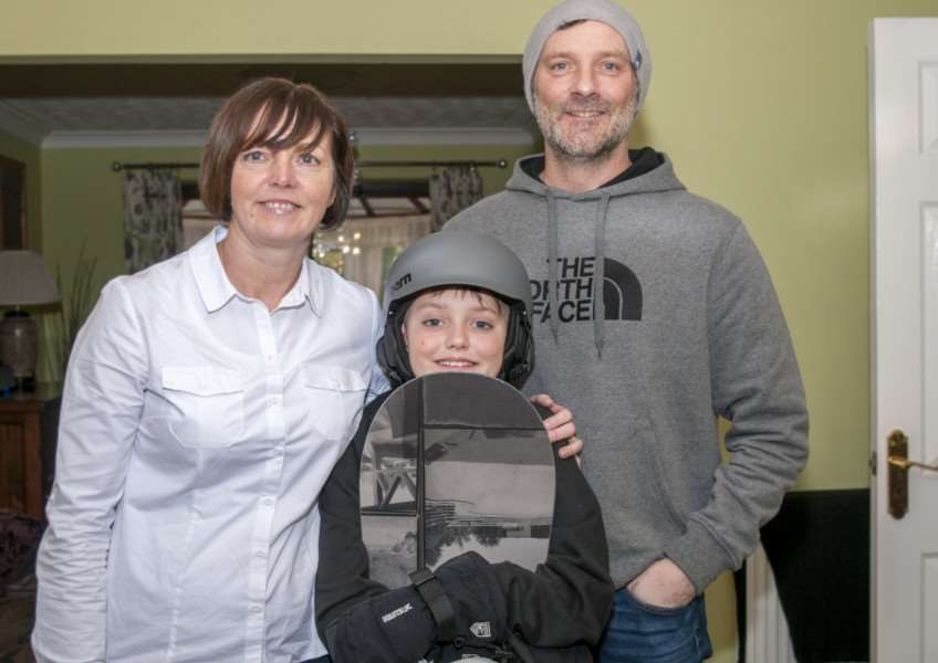 Snowboarder Ollie Wilson, 11, at home in Stamford with parents Phill and Julie