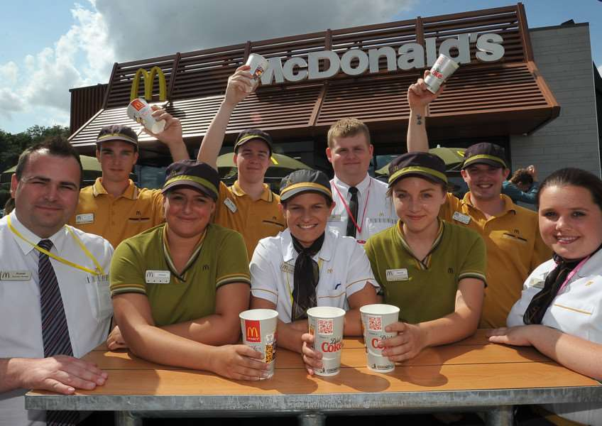 Staff at the opening day, in August 2014, of McDonald's Restuarant in Bourne, where safety matting within the children's playground was damaged and an outdoor shelter was scorched. Photo: MSMP-06-08-14-DL971.