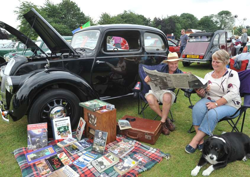Baston Car and Bike Show. Barbara and Allan Smith with their 1947 Morris 8 display EMN-140607-184930009