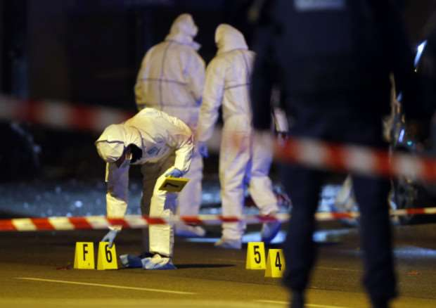 Investigating police officers work outside the Stade de France stadium. Picture: AP