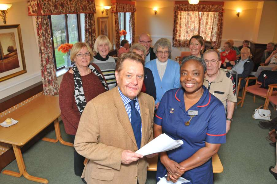 John Hayes MP with members and staff of a Dementia Support Group at Tanglewood Cedar Falls Care Home, Spalding, with matron Nike Ajewole. Photo by Tim Wilson.