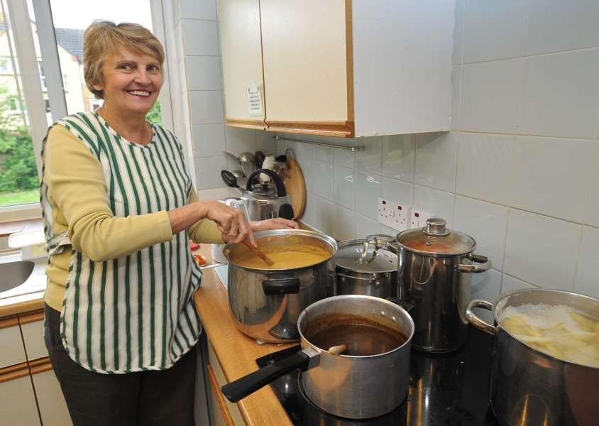 One of Evergreen Care Trust's volunteers prepares soup for the deliveries which are coming to an end