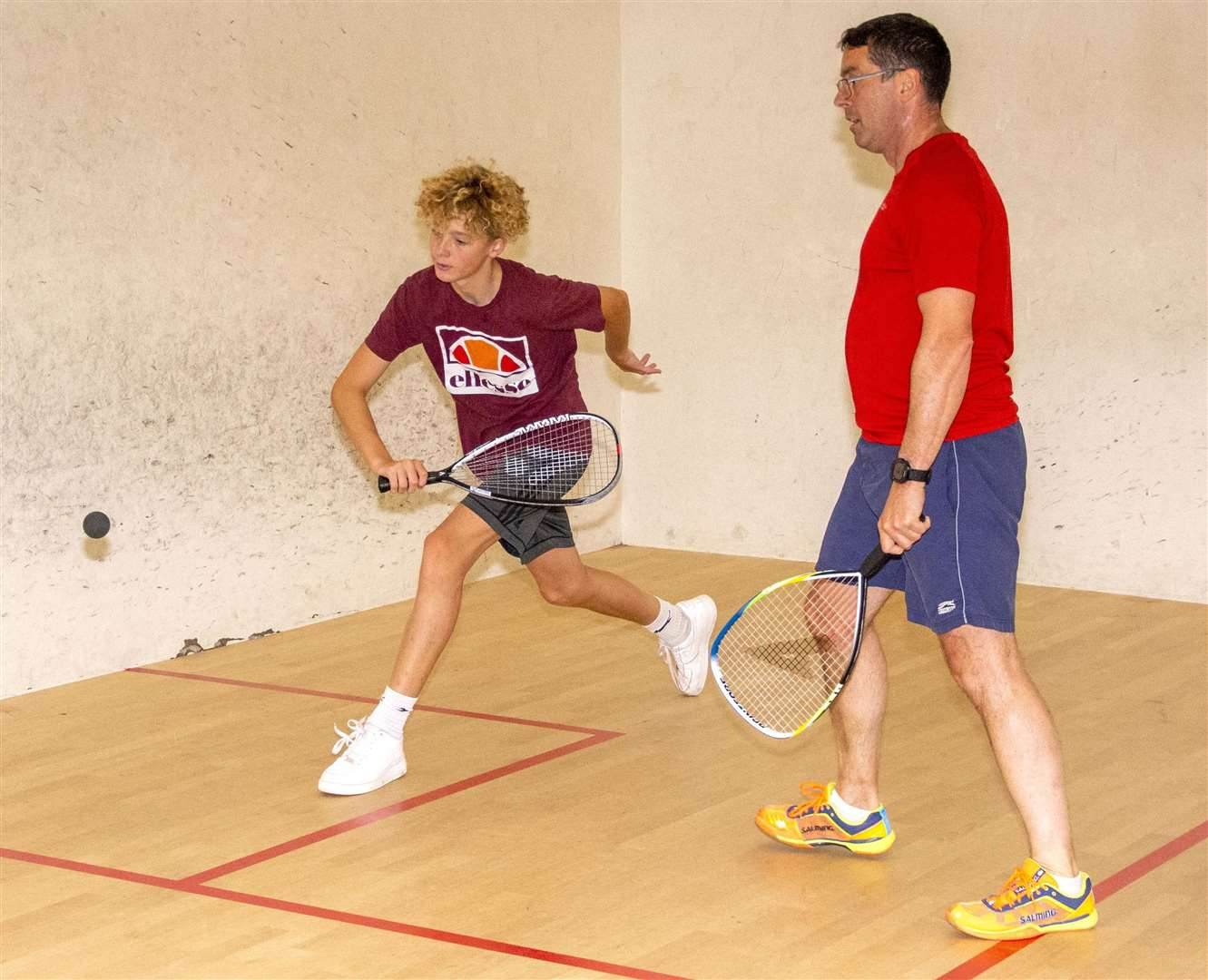 Treasurer Dave Spooner and son Eden, a junior ranked squash player, try their hand at squash 57.