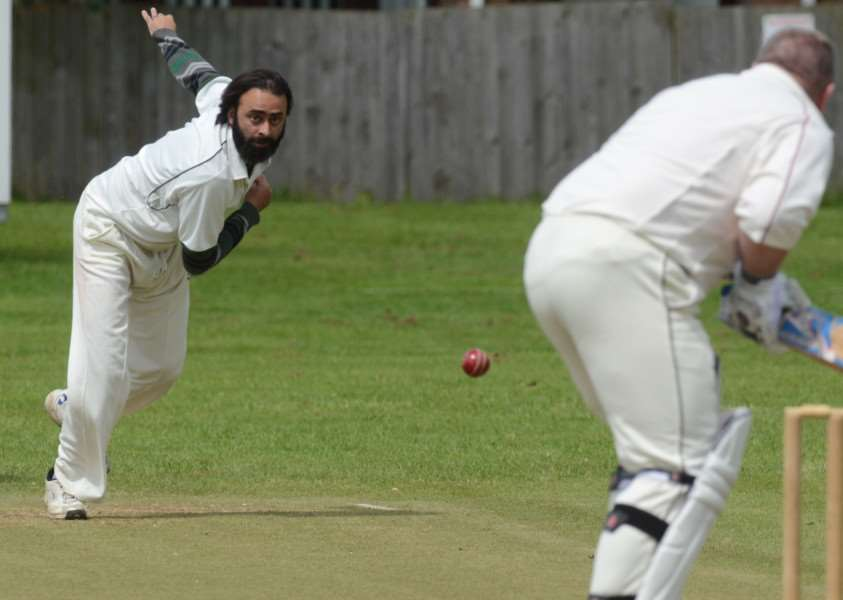 Asif Gul of Orton Park 2nds bowls to Dave Walker of Whittlesey 2nds. Photo: David Lowndes.