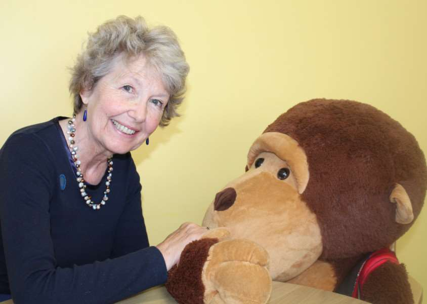 Bereavement volunteer, Louise Cameron with Charlie Chimp, Thorpe Hall's bereavement mascot EMN-150708-111917001