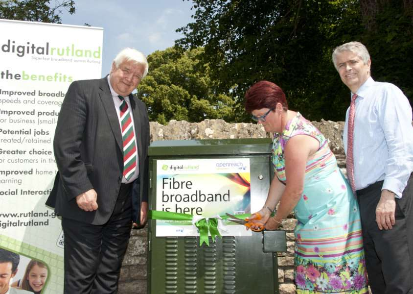 Rutland County Council leader Roger Begy, council chief executive Helen Briggs and BT managing director for next generation access Bill Murphy cut the ribbon at the first cabinet in North Luffenham as part of the �3m Digital Rutland project ENGEMN00120130717104338
