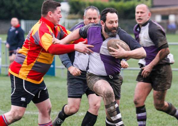 Centre Nick Maunder breaks the gain line for Stamford Rugby Veterans EMN-161002-165239001