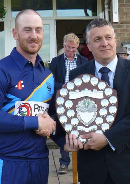 Bourne CC skipper Pete Morgan receives the Winkworth Trophy from Martin Thompson EMN-150526-095834001
