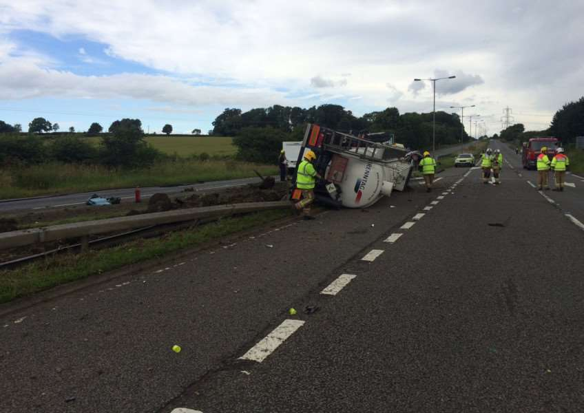The overturned HGV tanker on the A1 near Stoke Rochford, just south of Grantham EMN-161007-153426001 EMN-161007-153426001