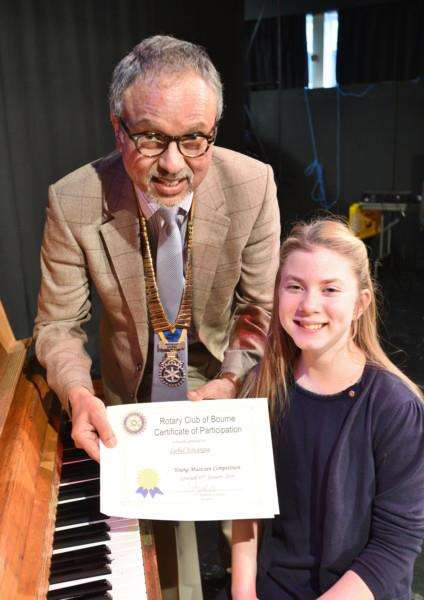 Rotary Club of Bourne Young Musician Competition 2016. Rotary president Jo Sunner presents certificate to Isobel Fovargue EMN-160117-172458009