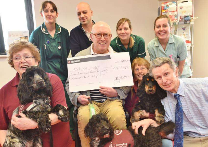 Rosemary Bristow and Lucy, Mike Wilson with Ronnie, Fabia Reeve with Remy and vet Bob Gillespie with staff from the Brye vets at Werrington at cheque pres to Hearing Dogs for Deaf People EMN-160103-164454009