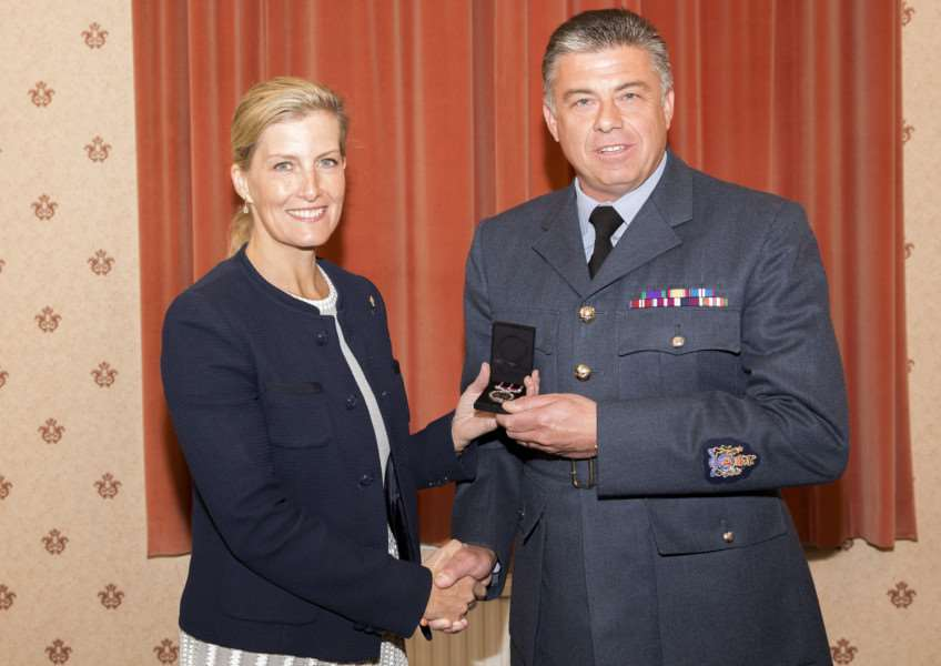 Warrant Officer Neil Paylor of RAF Wittering's Personnel Management Squadron receives his Meritorious Service Medal