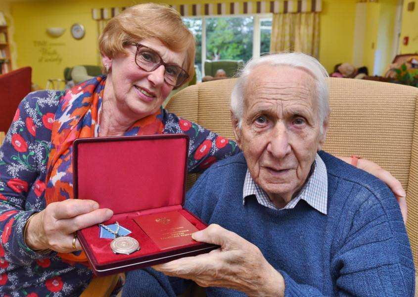 Ex-Royal Navy stoker Derrick Flatters who has received a medal from the Russian government. He is pictured with daughter Madalyn Gray at Whitefriars care home in Stamford EMN-161017-232541009