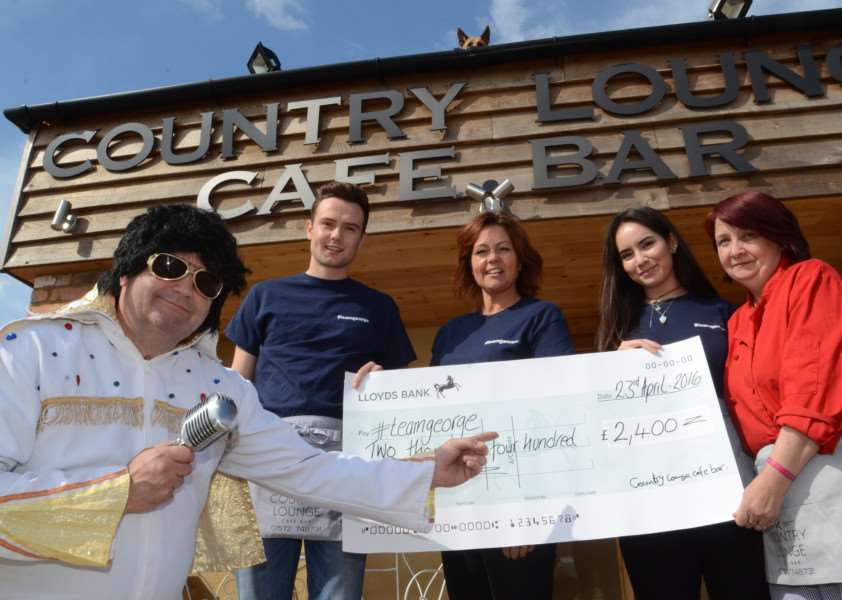 Allen Freeman (as Elvis) Bradley and Julia Freeman with Tani-Rose Rey and Wendy Saunders at the Country Lounge, Morcott with their charity cheque EMN-160428-170127001