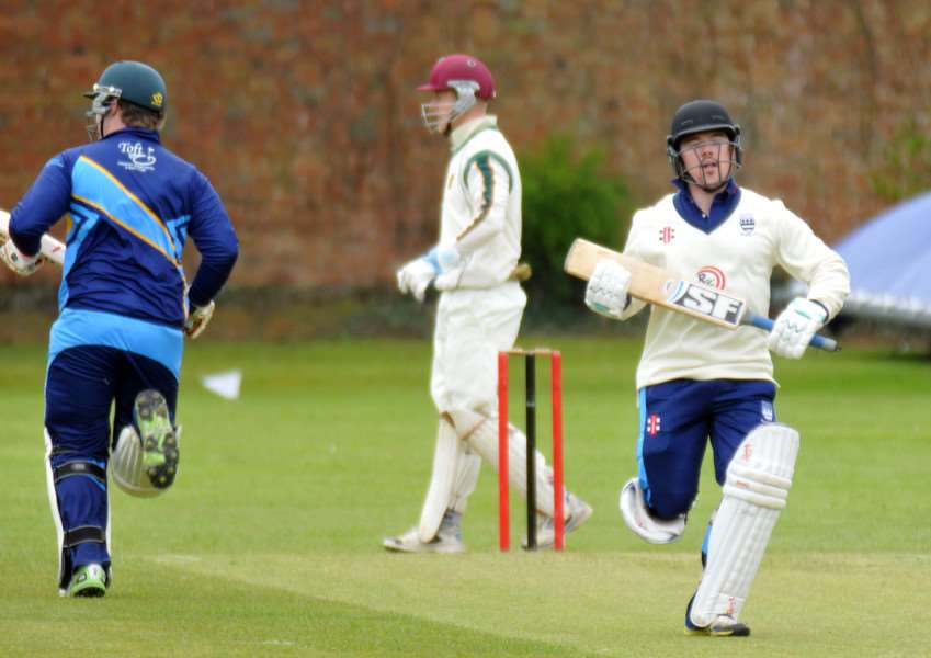 Robert Dunn (facing) and David Greenfield batting for Bourne against Grantham. Photo: Tim Wilson.
