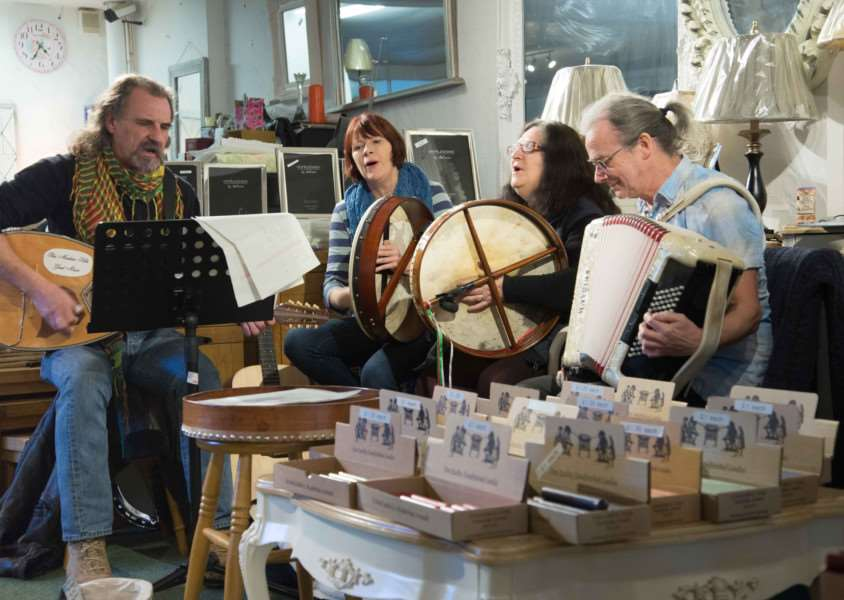 Folk musicians perform in Gilberts