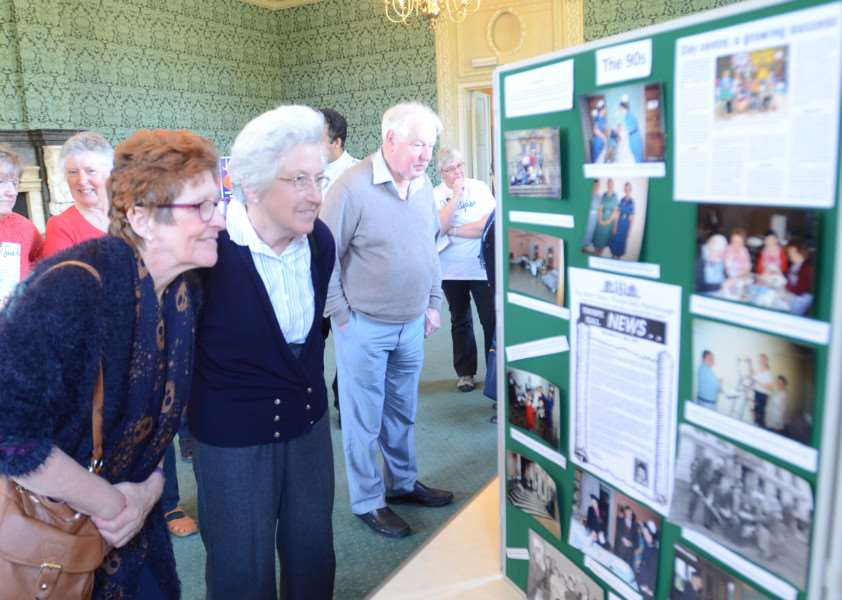 Open day for 25 year celebration at Sue Ryder Thorpe Hall. Visitors Margaret Belham and Rosemary Grove looking at photo display EMN-160420-163455009