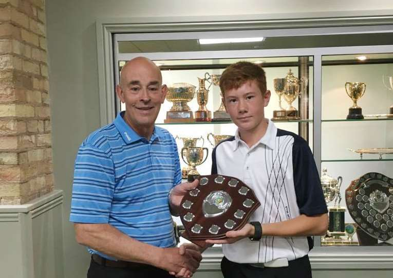 Greetham Valley Golf Club's Kian Pearce receives his trophy after winning the 2016 Ping Junior Open at Gainsborough Golf Club EMN-160830-105958002