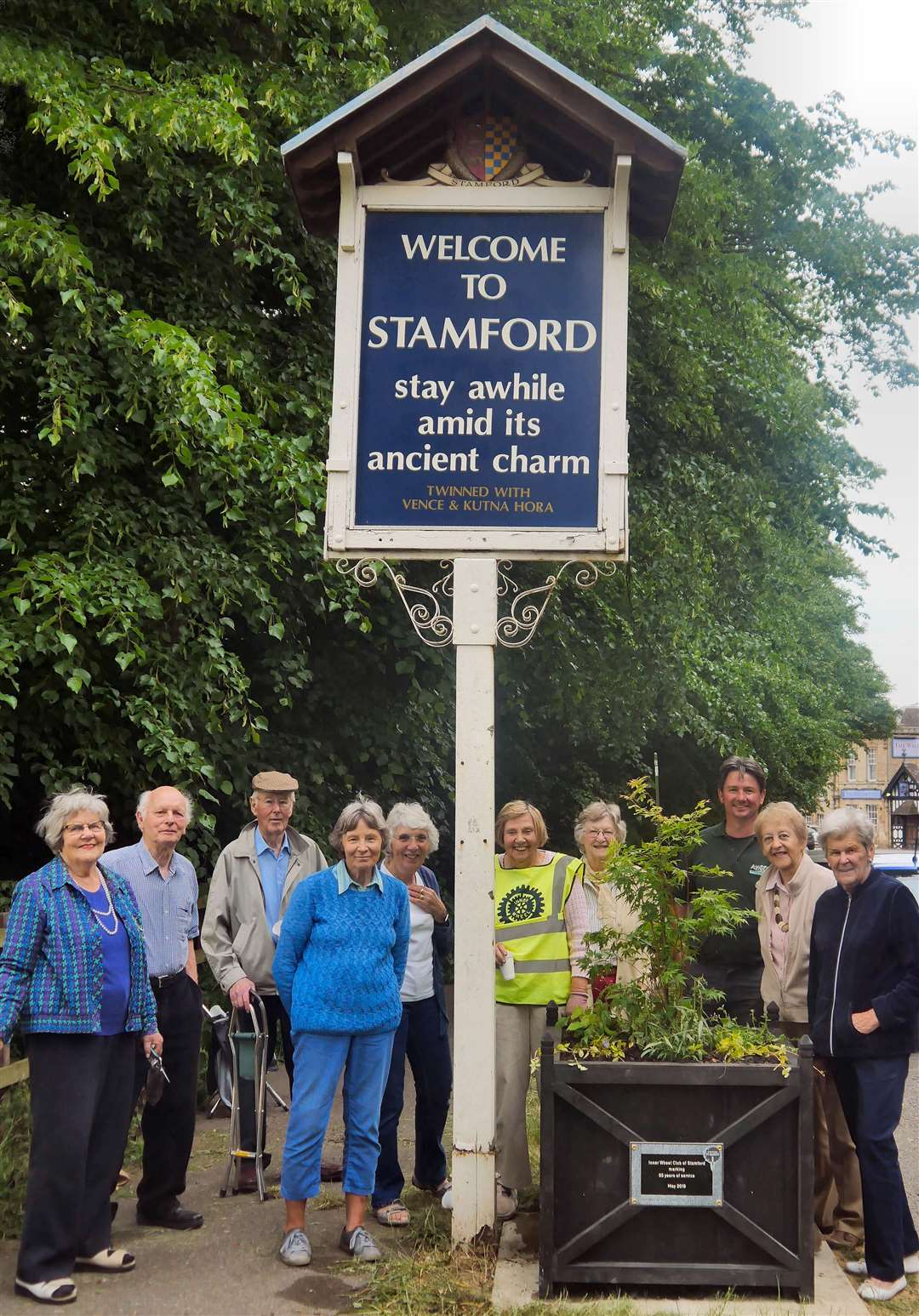 Inner Wheel Club of Stamford members with the flower box at the entrance to the town