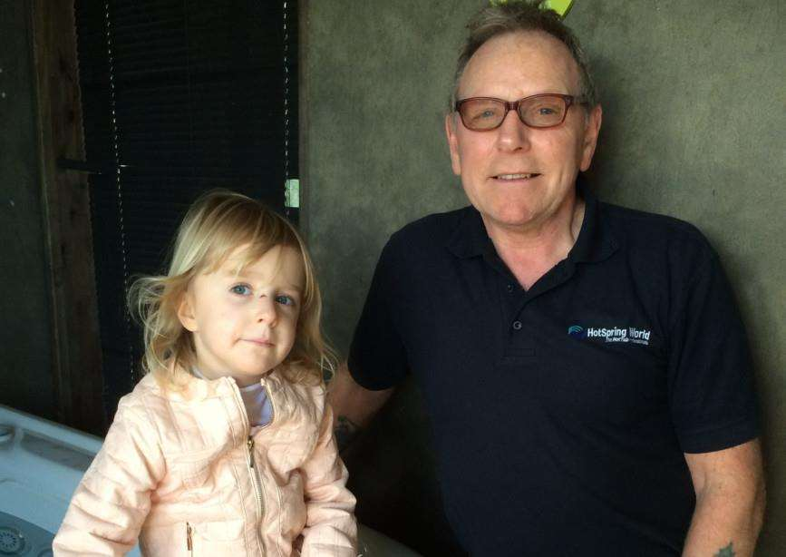 Phoebe Crowson, aged five with Bill Harbison from HotSpring World in Peterborough who have donated a hot tub for the auction. EMN-151103-161206001