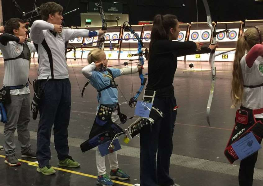 DAVID AND GOLIATH: Matilda Craven (centre) shoots at the Junior National Indoor Championships at Stoneleigh Park, Warwickshire.