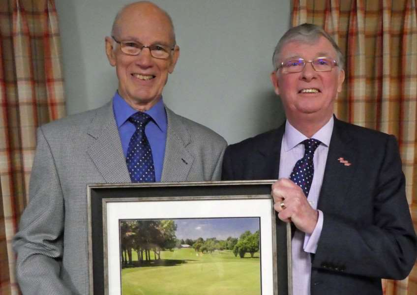 David Elliott (left) receives his 50 year award at Burghley Park from club captain Bill O'Driscoll.