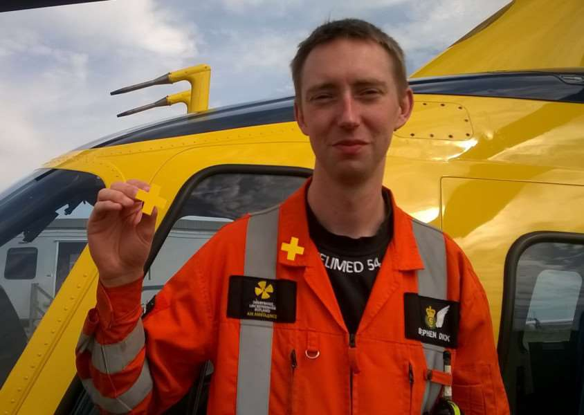 Critical care paramedic Steve Dick with one of the badges EMN-150722-142517001