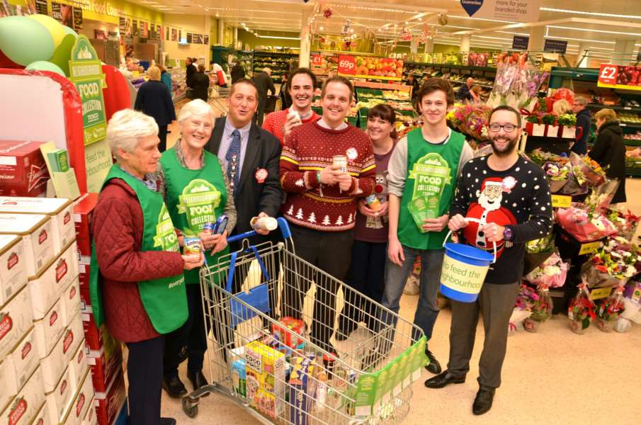 Volunteers from Deepings Foodbank at Tesco Superstore, Market Deeping, for their annual Christmas collection with store staff and volunteers Catrheryn Seale, Janis Hewitt and Ben Rowe. Photo by Tim Wilson.