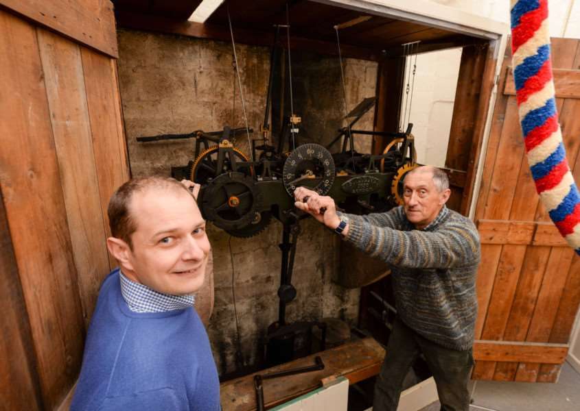 The restoration of the clock at All Saints Church in Oakham. Louis Totaro with Nigel Campion winding the clock'Photo: Alan Walters EMN-160405-175232001