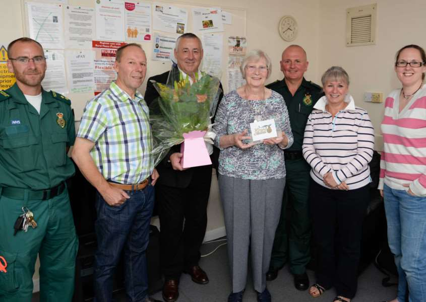 Oakham ambulance station cleaner June Fosker receives a chief executive's commendation from East Midlands Ambulance Service. From left, Simon Herrick, David Collin, Anthony Graham, June Fosker, Mick Jones, Sally Davies and Emma Redwood. Photo: Alan Walters MSMP-17-08-18aw011 EMN-150821-152051001