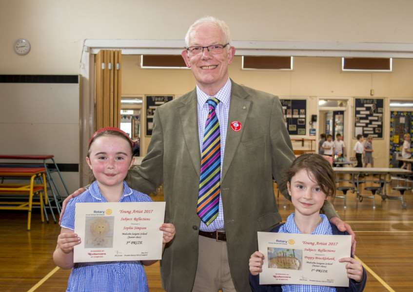 Sophie Simpson (left) and Poppy Brocklebank, holding their cetificates, with Jim Guthrie from the Rotary Club of Stamford. By Lee Hellwing.