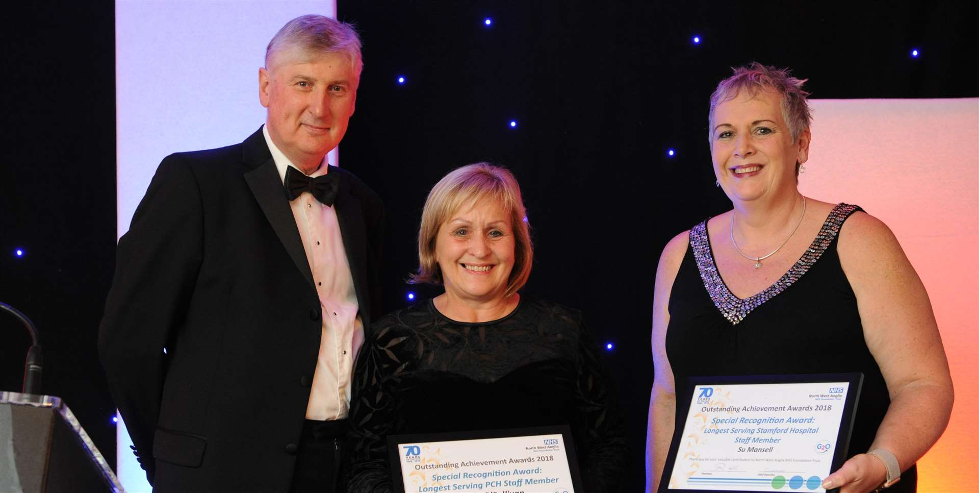 Rob Hughes, chairman of North West Anglia NHS Trust, with long serving staff members Angie O'Sullivan and Su Mansell