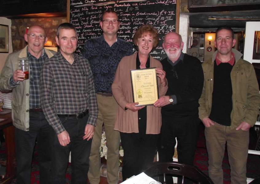 The Melton CAMRA judging team and the winning landlords. Pictured from left are Harvey Hopwood, Nigel Wood, Kevin Billson, Carol and Jeff Evans and Geoff Helstrip EMN-150520-200849001