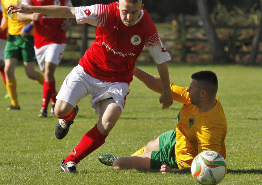 Action from Oakham United against Irchester United in the UCL Division One. Photo: Geoff Atton EMN-150914-142248001
