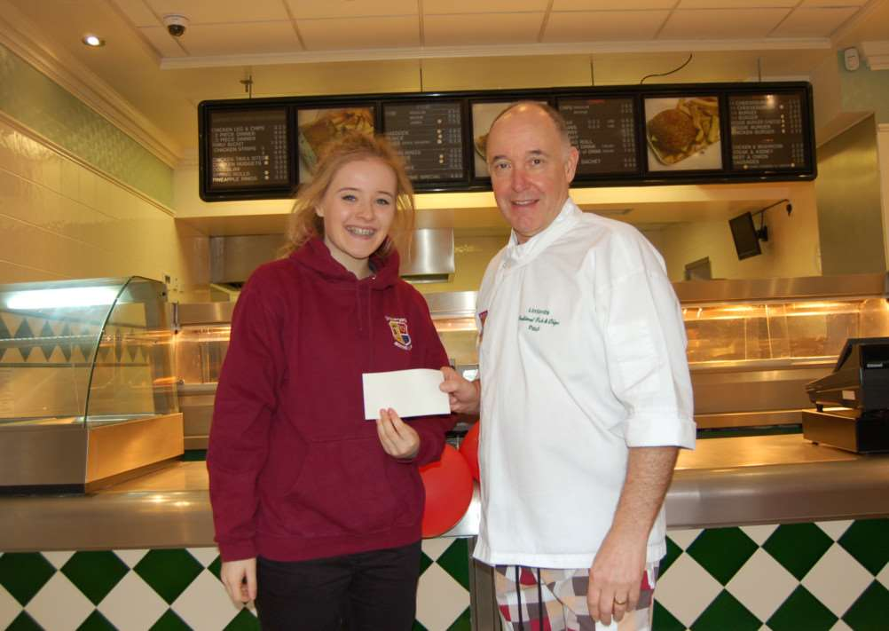 Deeping boxer Leah Mann collects a cheque from Paul Linford, of Linford's Firsh and Chips shop to go towards Stamford ABC's new boxing ring EMN-150318-135723001