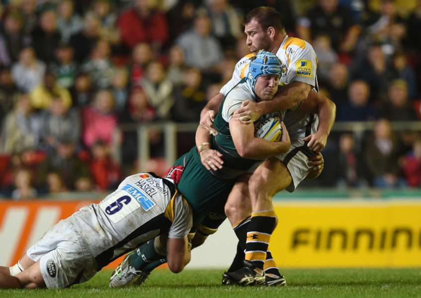 Leicester Tigers' Jordan Crane (centre) is tackled by Wasps' James Haskell (left) and Lorenzo Cittadini during the Aviva Premiership match at Welford Road. Photo: Joe Giddens/PA Wire. EMN-150311-090446001