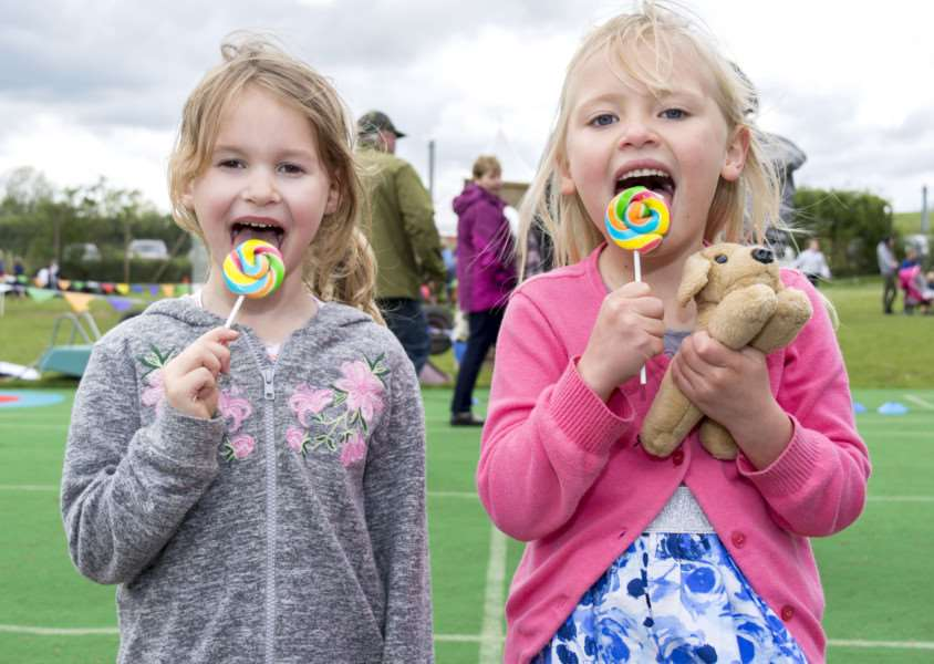 Youngsters Lucy Massey and Hannah Woodward enjoy lollies at the fete