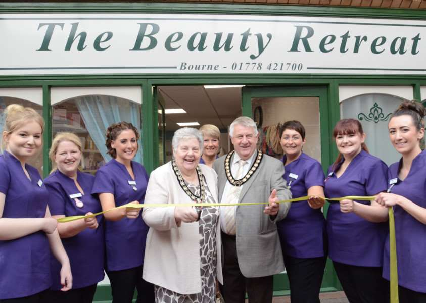 Bourne mayor and mayoress Philip and Norma Knowles with staff at the opening of the Beauty Retreat at Bourne EMN-160522-002900009