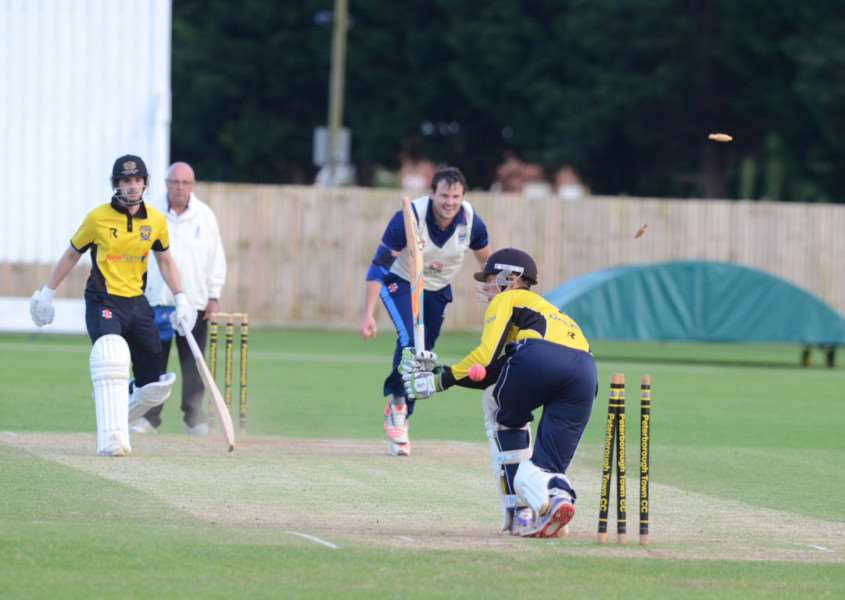 Peterborough Town's Scott Howard is clean bowled by Colin Cheer of Bourne.