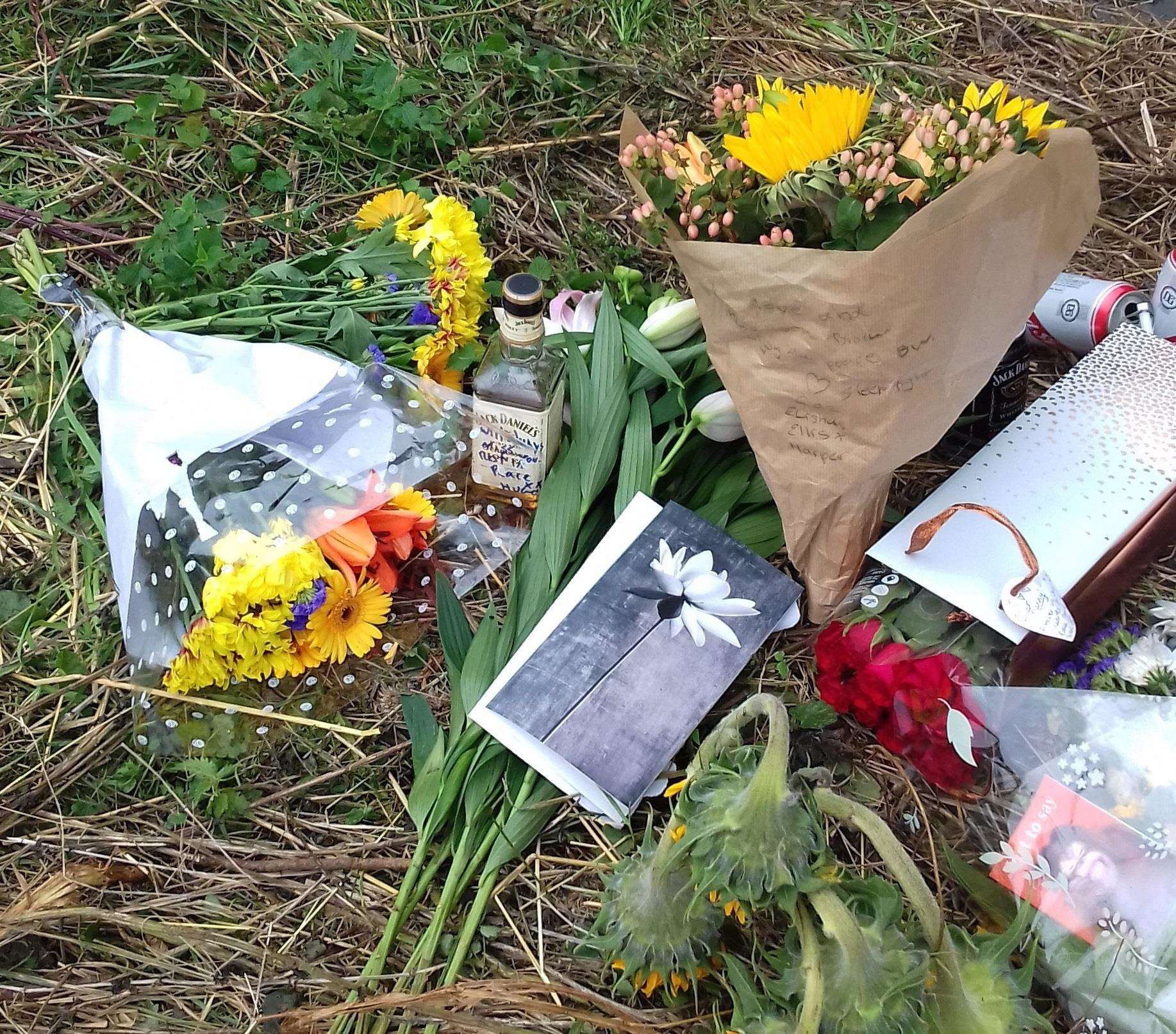 Floral tributes and cards to Danny at the site where he died (4011225)