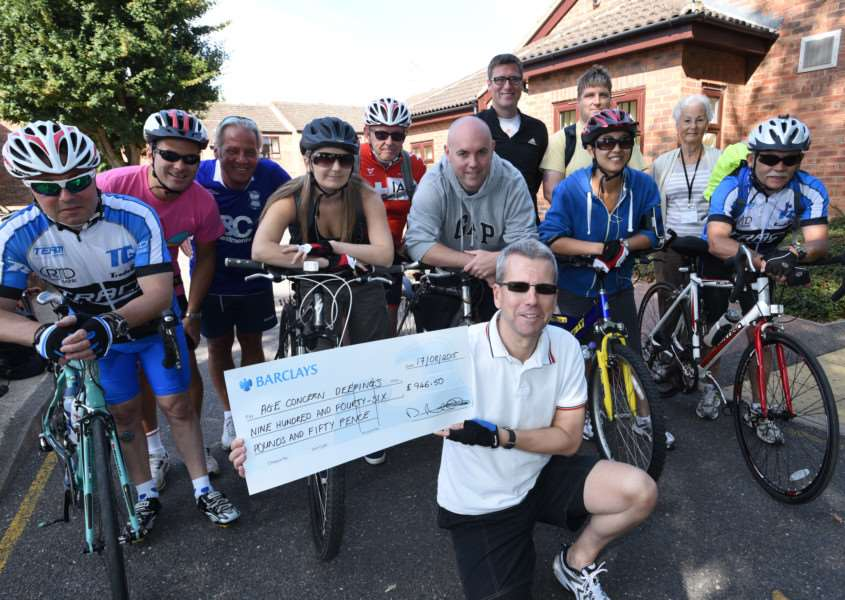 AOS Security bike ride in aid of Age Concern, Deepings. Pictured with the cheque is Mick Elliott with Brenda Hurl (back right) from Age Concern EMN-150817-155004009