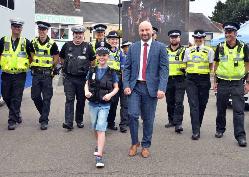"Marc Jones ""on the beat"" in Spalding with Arthur Waters and police officers from the town at a community engagement day in Sheep Market car park, Spalding. Photo by Tim Wilson."